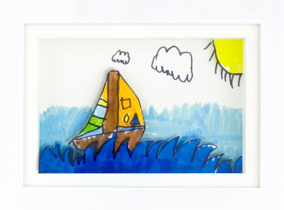 Shadowbox featuring artwork that includes a sailboat.