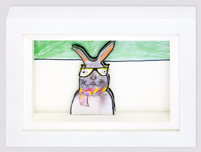 Shadowbox featuring artwork of a rabbit with glasses.