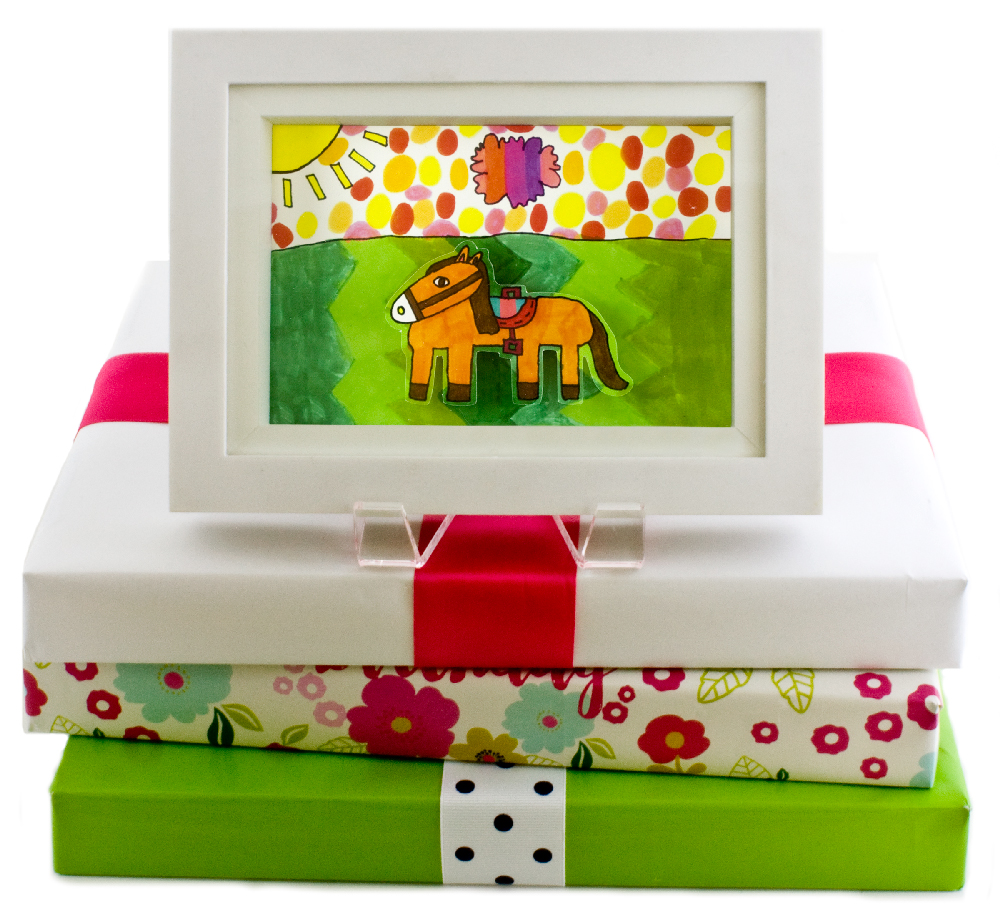 KidsArt, Inc. shadowbox on stack of presents.