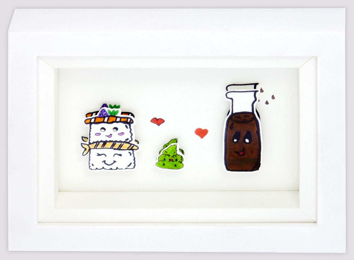 Shadowbox featuring artwork of sushi.