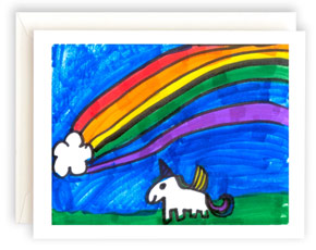 A note card featuring artwork with a unicorn and rainbow.